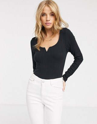 New Look notch detail long sleeve ribbed top in black