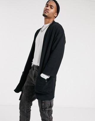 Asos Design DESIGN extreme oversized kimono cardigan in black with baggy pocket details
