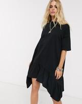 Asos Design DESIGN oversized smock dress with tiered dip hem in black