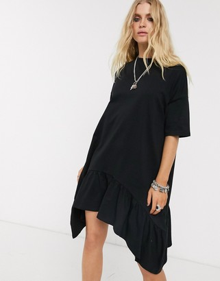ASOS DESIGN oversized smock dress with tiered dip hem in black