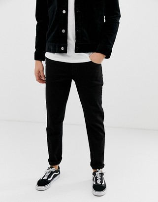 ASOS DESIGN tapered jeans in black