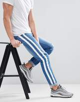 boohooMAN Skinny Jeans With Stripe Print In Blue Wash