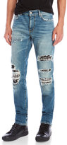 Saint Laurent Rip-And-Repair Distressed Studded Jeans