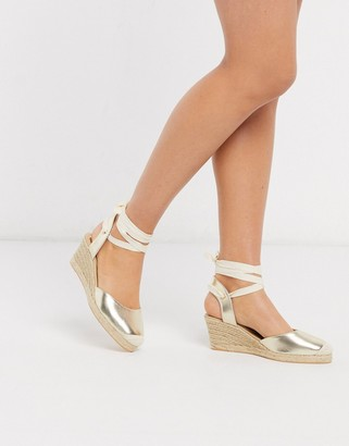 London Rebel espadrille wedges in gold