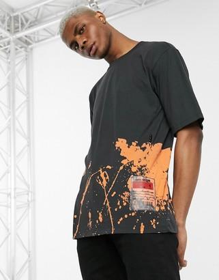 Religion drop shoulder t-shirt with colour splat detail in black