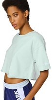 Ivy Park Peached Raw Edge Crop Short Sleeve Sweatshirt