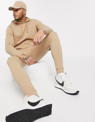 ASOS DESIGN tracksuit with hoodie & skinny cargo sweatpants in beige