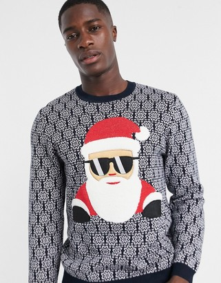 ASOS DESIGN Knitted Charity Christmas sweater with cool Santa applique for ASOS Foundation