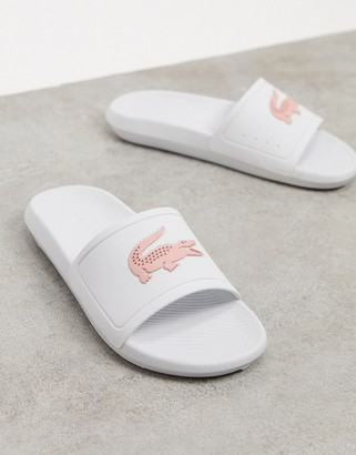 Lacoste Croco logo slides in white and pink