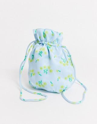 Faithfull The Brand Faithfull floral drawstring pouch in satin-Blue