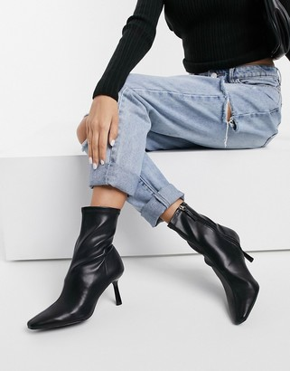 Stradivarius skinny heeled boots in black