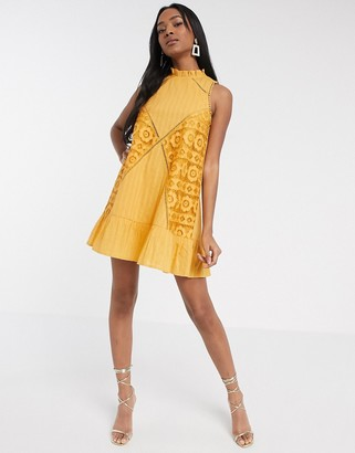 ASOS DESIGN sleeveless lace insert mini dress with pephem in mustard