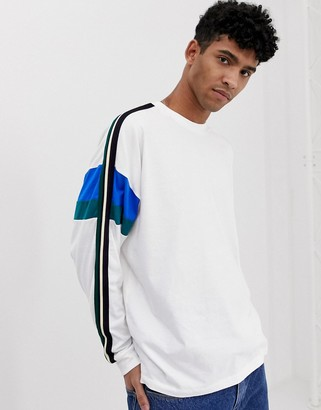 Asos Design DESIGN oversized long sleeve t-shirt with sleeve cut and sew and taping in white