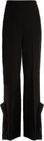 Toga Ruffled slit-hem high-rise trousers