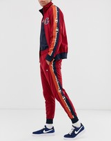 Champion Tricot track pants with taping in red