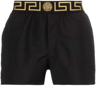 Versace Greca-print swim shorts