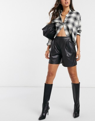 Vila high-waisted leather-look shorts in black
