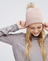 Asos Rib Beanie With Oversized Natural Faux Fur Pom
