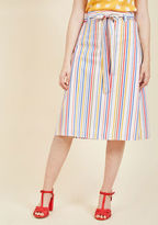 If this cotton midi skirt could speak, we imagine it would sing with excitement over such a darling design! Inspired by the founding siblings' travels, this sash-tied sweetheart will make you feel equally giddy with its high waistline and red, blue, pink,