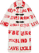 Gucci Mink coat with red intarsia script