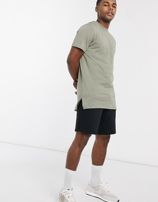 ASOS DESIGN longline t-shirt with side splits in washed khaki