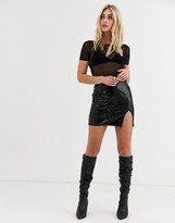 Motel mini skirt with front split in faux croc