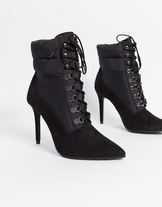 Call it SPRING onorecia stiletto boots with quilted collar in black