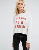 Billabong Cropped Open Back Sweatshirt With Freedom Print