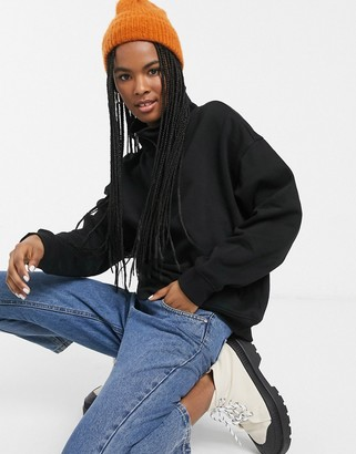 Monki organic cotton and recyled polyester zip front high-neck sweat in black
