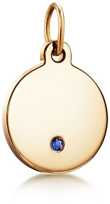 Tiffany & Co. Charms round tag in 18k gold with a sapphire, mini