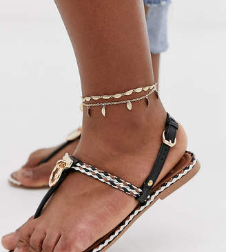 Asos DESIGN Curve pack of 2 anklets with feather pendants in gold tone