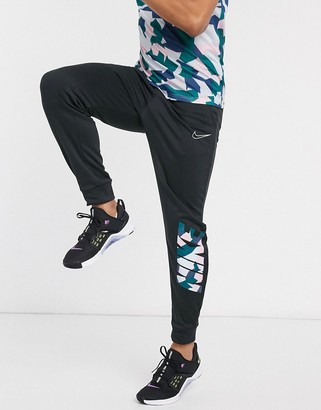 Nike Training joggers in black with camo placement print