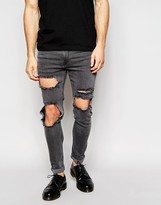 Asos Super Skinny Jeans With Open Rips In Washed Black