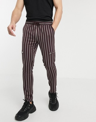 ASOS DESIGN skinny trousers with elastic waist in stripe with zip detail