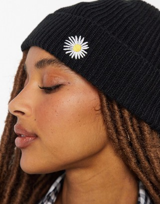 ASOS DESIGN fisherman rib beanie with daisy embroidery in black