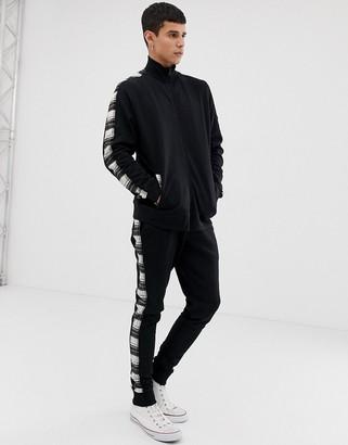 Asos Design DESIGN tracksuit track neck jersey jacket / skinny sweatpants with check side stripe-Black