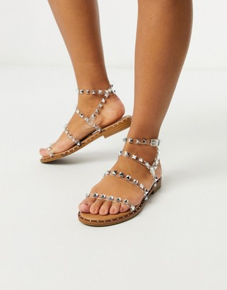 Steve Madden Travel strappy flat sandal with stud detail in clear