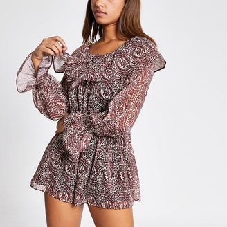 River Island Beige printed long sleeve frill playsuit