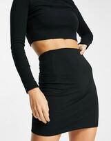 Asos DESIGN seamed super mini bodycon skirt in black