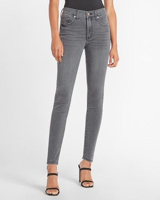 Express Mid Rise Faded Black Skinny Jeans