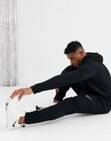 Nike Training Dri-Fit tapered fleece sweatpants in black