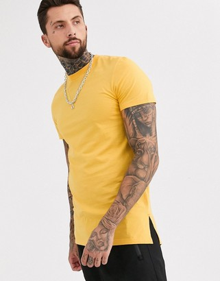 ASOS DESIGN longline t-shirt with crew neck and side splits in yellow