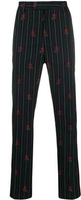 Alexander McQueen rose embroidered pinstriped trousers
