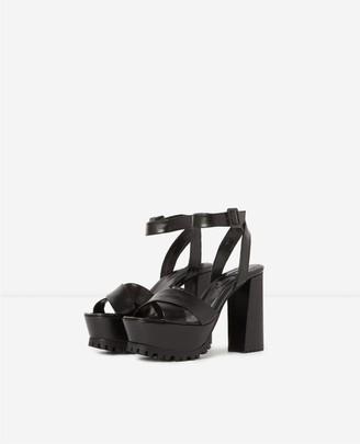 The Kooples Notched black platform sandals in leather