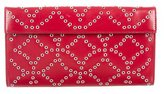 Alaia Leather Grommet-Embellished Clutch