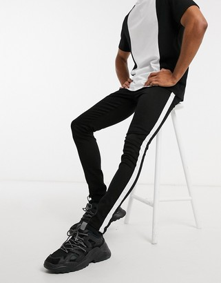 Criminal Damage skinny fit jeans with side tape detail in black