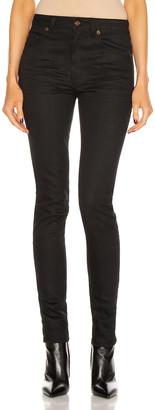 Saint Laurent Medium Waist Skinny Jean in Used Black | FWRD