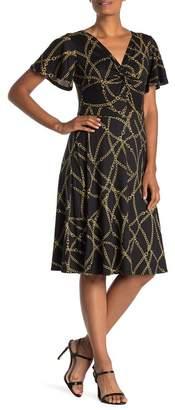 SUPERFOXX Flutter Sleeve Knotted Dress