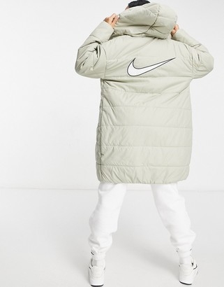 Nike longline padded jacket with back swoosh in stone