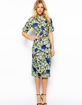 kourtney kardashian  Who made  Kourtney Kardashians green and blue floral print dress?